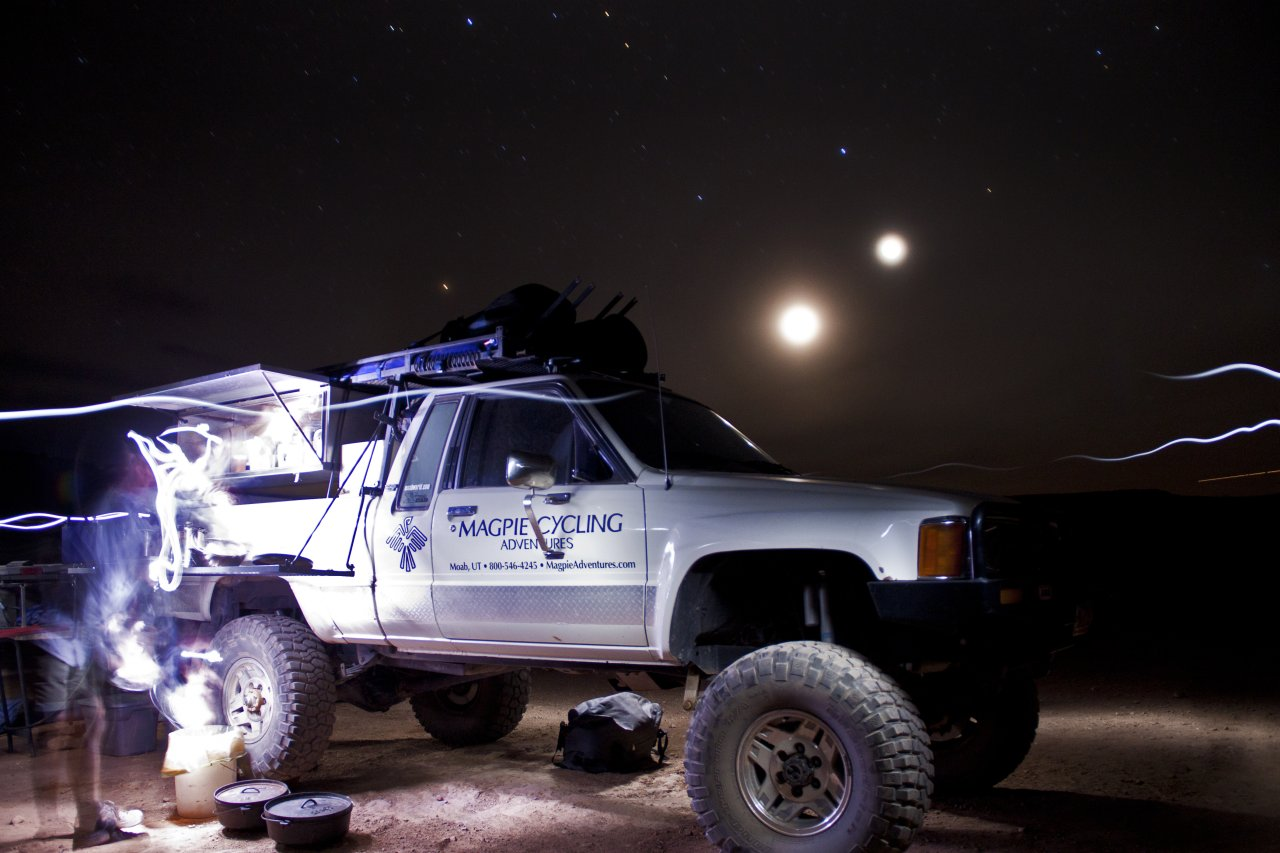 White Rim truck and Guide at night